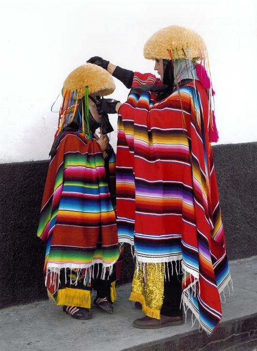 An adult Parachico helping a young Parachico with a montera ('a round wig made of ixtle'), Chiapa de Corzo, Mexico / © 2009 Coordinación Ejecutiva para la conmemoración del Bicentenario de la Independencia Nacional y del Centenario de la Revolución Mexicana del Estado de Chiapas @ UNESCO Archive