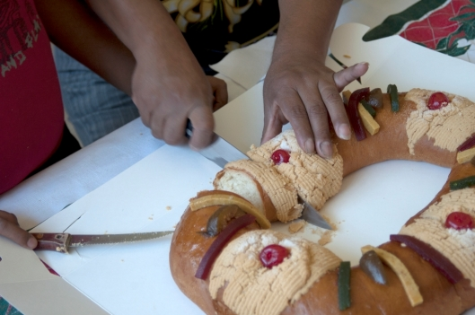 The child is sharing a Rosca de Reyes with his mum, Oaxaca, Mexico / Andreja Brulc